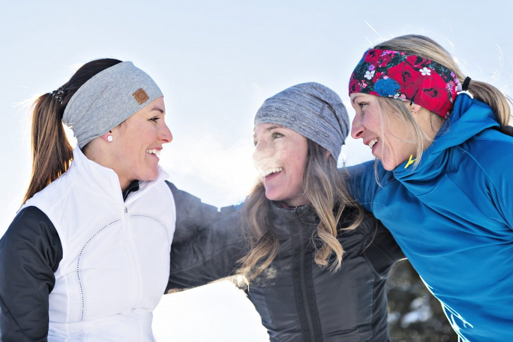 Women laughing in winter clothing