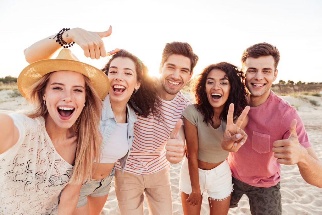 Young people having fun on beach