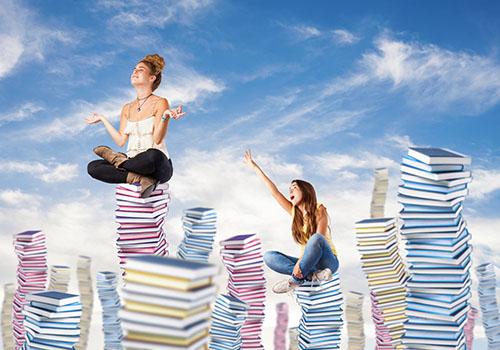 Women sitting on books